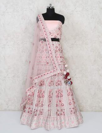 Bridal peach semi stiched lehenga choli for wedding in net