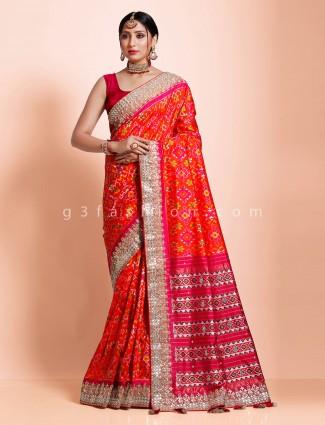 Bridal wear orange hydrabadi patola silk saree
