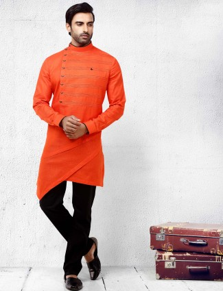 Bright orange hued festive wear kurta suit