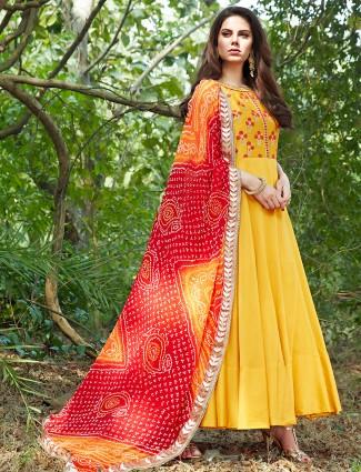 Bright  yellow silk anarkali suit