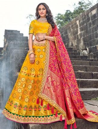 Bright yellow silk lehenga choli for wedding bride