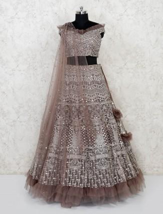 Brown lehenga choli in net fabric