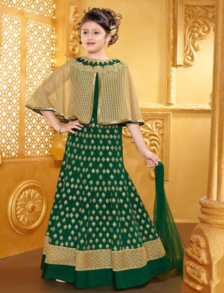 Cape style lehenga choli in green silk fabric