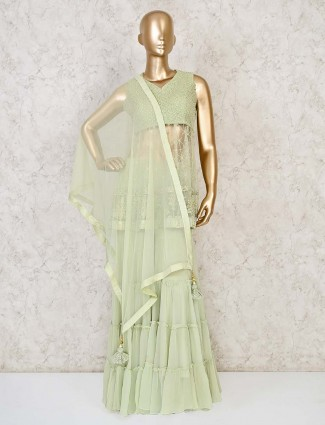 CDesigner pista green sharara salwar suit in georgette