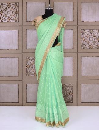 Chiffon fabric saree in sae green color
