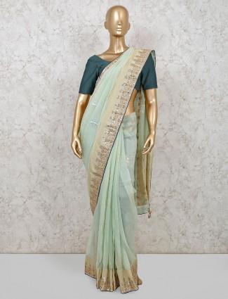 Classic pista green organza tissue silk saree
