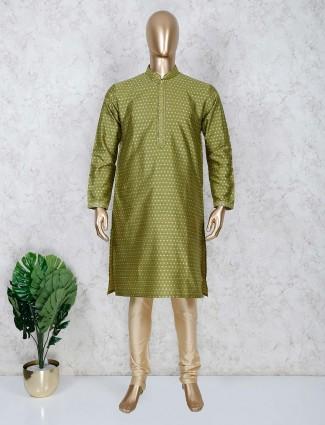 Cotton fabric green color kurta suit festive wear
