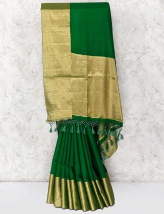 Cotton silk fabric green hued saree