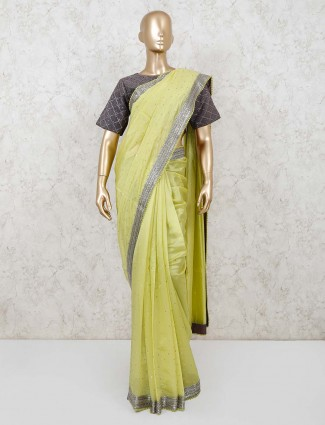 Cotton silk green festival saree with readymade blouse