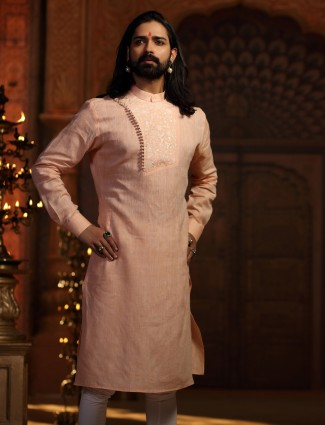 Cotton silk peach kurta suit for festive function