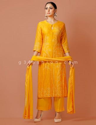 Cotton silk yellow sober printed punjabi pant suit