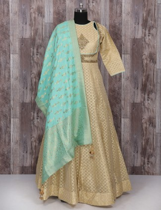 Cream and aqua color net wedding anarkali suit