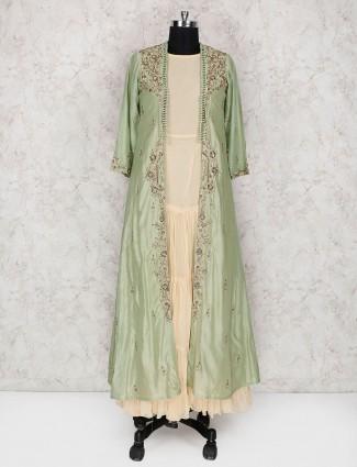 Cream and green hue cotton silk jacket style kurti