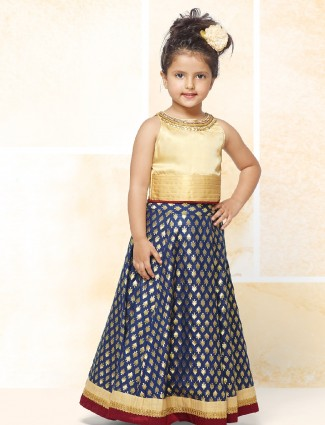 Cream and navy color choli suit