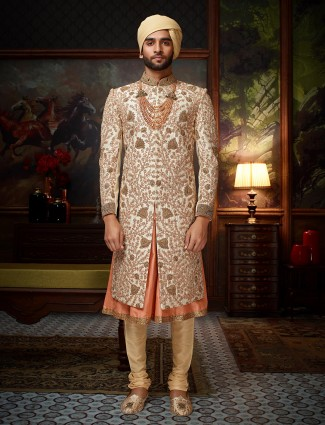 Cream and peach raw silk groom sherwani