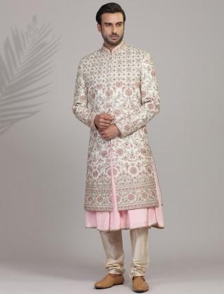 Cream and pink silk sherwani for groom