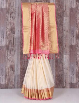 Cream and pink wedding silk saree