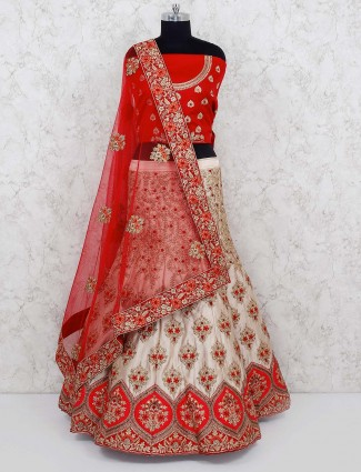 Cream and red bridal wear semi stitched lehenga choli in silk
