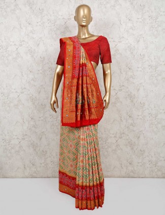 Cream and red color patola silk saree