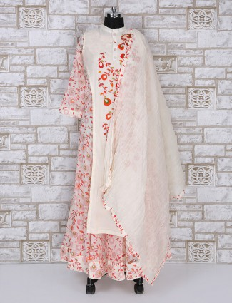 Cream and red colored silk anarkali suit