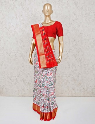 Cream and red ikat thread weaving Hyderabadi patola silk saree