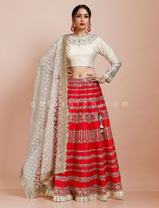 Cream and red party lehenga choli in silk