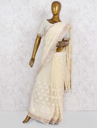 Cream color festive georgette saree