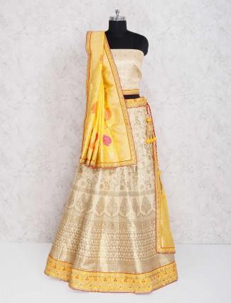 Cream color silk semi stitched lehenga choli