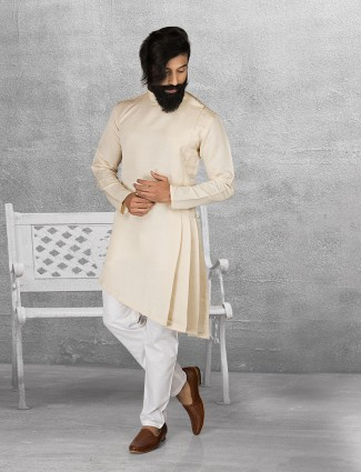 Cream color terry rayon solid kurta suit