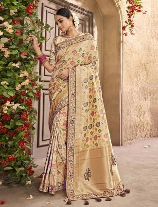 Cream color wedding saree in banarasi silk fabric