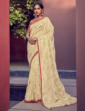 Cream cotton silk saree with red blouse for party
