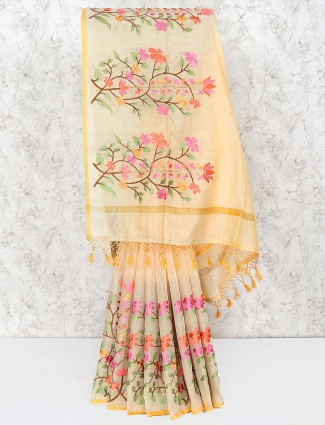 Cream hue cotton festive saree