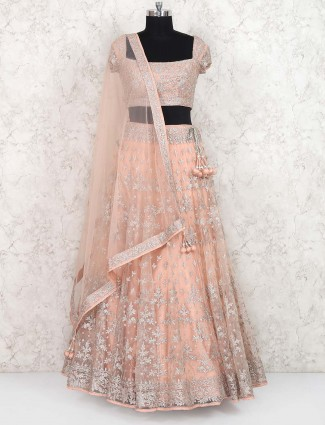 Peach hue net party wear lehenga choli