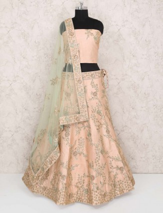 Cream hue raw silk pretty semi stitched lehenga choli