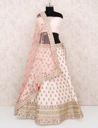 Cream hue silk wedding semi stitched lehenga choli