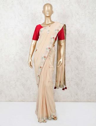 Cream pashmina silk saree with heavy lace border