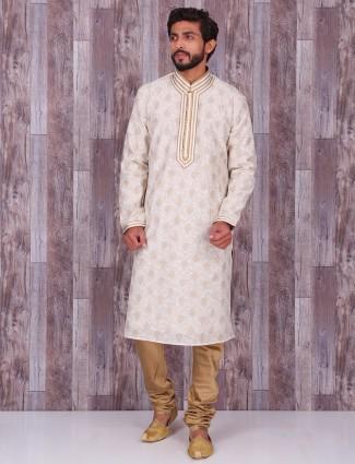Cream printed cotton silk kurta suit