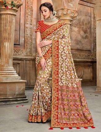 Cream pure patola silk saree design for wedding