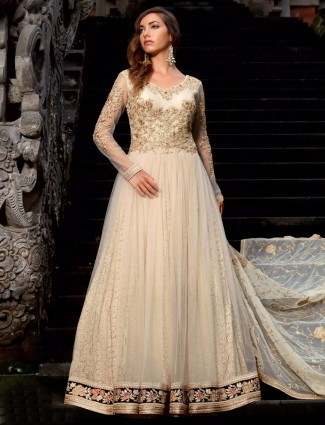 Cream semi stitched net wedding wear anarkali salwar suit