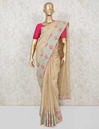 Designer beige coloured linen saree