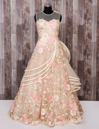 Designer cream color net gown