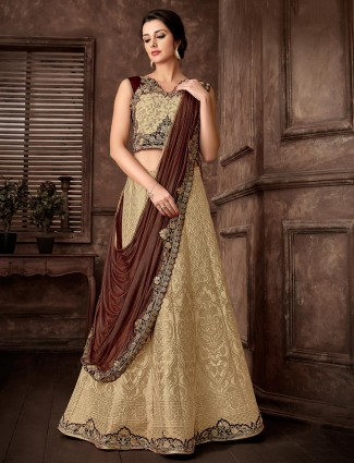 Designer gold and brown lehenga cum saree for wedding in lycra and banarasi silk
