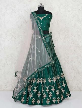 Designer green semi stitched lehenga in raw silk for wedding function
