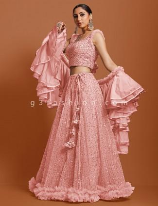 Designer peach net wedding wear lehenga choli