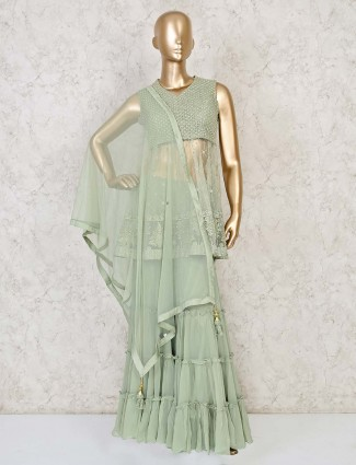 Designer sea green sharara salwar suit in net for festivals