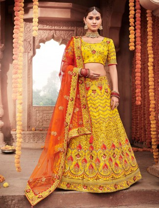 Designer wear semi stitched lehenga choli yellow in silk