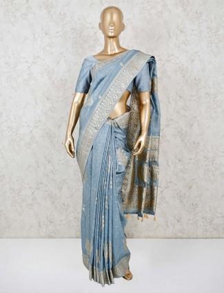 Dola silk grey tassels trimmed pallu saree