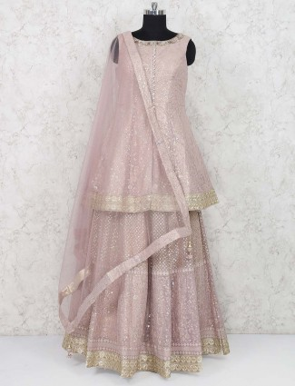 Dusty pink colored tissue silk lehenga choli