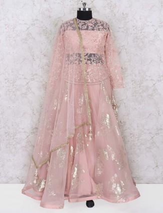 Dusty pink colored tissue silk wedding lehenga choli