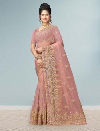 Dusty pink wedding net saree